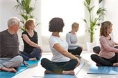 Stock Picture-People stretching seated on mats
