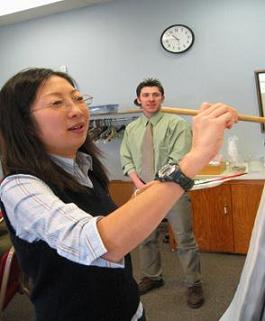 Student from SCSU presenting a Japanese Tea Ceremony and Calligraphy at WSC